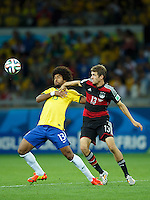Dante of Brazil and Thomas Muller of Germany