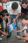 30 June 2006: A group of young fans set fire to an Argentina flag as Germany fans celebrate in the town square in Frankfurt, site of several games during the FIFA 2006 World Cup. Germany had just defeated Argentina in a Quarterfinal game played in Berlin.