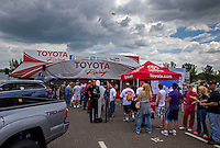 May 30, 2014; Englishtown, NJ, USA; NHRA fans line up at Toyota Pit Pass display on the midway during qualifying for the Summernationals at Raceway Park. Mandatory Credit: Mark J. Rebilas-