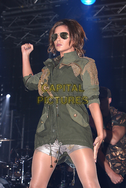 CHERYL COLE .Performs live during Radio One's Big Weekend, Bangor, North Wales, .UK, May 22nd 2010..1 1's music live on stage concert gig half length black sunglasses hand arm green khaki parka jacket coat grey gray silver shorts .CAP/MAR.© Martin Harris/Capital Pictures.