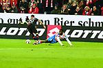 am Boden der Mainzer Moussa Niakhate mit dem Leverkusener Karim Bellarabi beim Spiel in der Fussball Bundesliga, 1. FSV Mainz 05 - Bayer 04 Leverkusen (dunkel).<br /> <br /> Foto &copy; PIX-Sportfotos *** Foto ist honorarpflichtig! *** Auf Anfrage in hoeherer Qualitaet/Aufloesung. Belegexemplar erbeten. Veroeffentlichung ausschliesslich fuer journalistisch-publizistische Zwecke. For editorial use only. DFL regulations prohibit any use of photographs as image sequences and/or quasi-video.