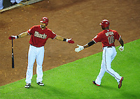 Jun. 1, 2011; Phoenix, AZ, USA; Arizona Diamondbacks outfielder Chris Young (left) congratulates Justin Upton after his sixth inning RBI ground out against the Florida Marlins at Chase Field. Mandatory Credit: Mark J. Rebilas-