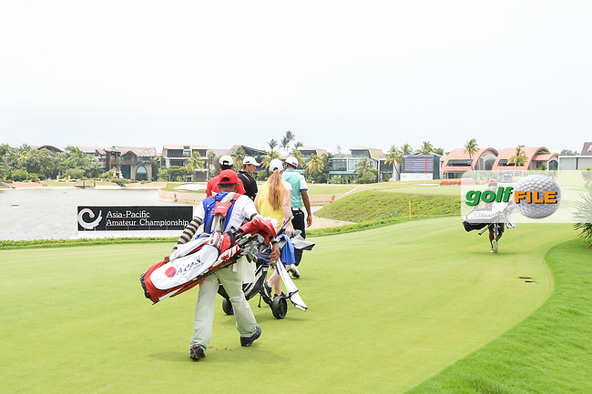 Kazuya OSAWA (JPN), Daniel HILLIER (NZL), and Yuvraj SANDHU (IND) head down 17 during Rd 3 of the Asia-Pacific Amateur Championship, Sentosa Golf Club, Singapore. 10/6/2018.<br /> Picture: Golffile   Ken Murray<br /> <br /> <br /> All photo usage must carry mandatory copyright credit (© Golffile   Ken Murray)