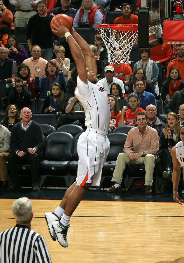 Virginia guard Justin Anderson (1) prepares to dunk the ball in the first half of the game Wednesday Jan. 7, 2015 in Charlottesville, Va. Virginia won 61-51.