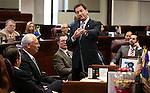Former Nevada Lt. Gov. Brian Krolicki, center, speaks during a ceremony on the Senate floor at the Legislative Building in Carson City, Nev., on Thursday, Feb. 12, 2015. <br /> Photo by Cathleen Allison