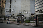 "Athens, Greece, January 25, 2015. Writings on the wall saying ""tormented"" seen all over the city."