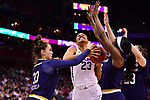 COLUMBUS, OH - MARCH 30: Azura Stevens #23 of the Connecticut Huskies drives the lane between Kathryn Westbeld #33 of the Notre Dame Fighting Irish  and Jackie Young #5 of the Notre Dame Fighting Irish during a semifinal game of the 2018 NCAA Division I Women's Basketball Final Four at Nationwide Arena in Columbus, Ohio. (Photo by Ben Solomon/NCAA Photos via Getty Images)