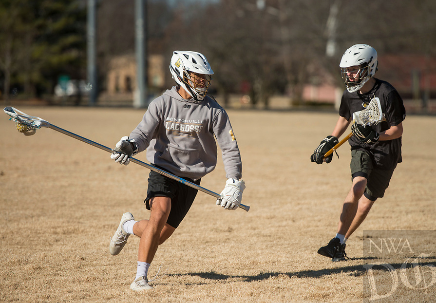 NWA Democrat-Gazette/BEN GOFF @NWABENGOFF<br /> Cedrick Sanchez (left) and Trevor Bolena, both of Bentonville, practice lacrosse Saturday, Jan. 5, 2019, at Old Tiger Stadium Park in Bentonville. The boys play for the Bentonville combined high school lacrosse team, and open their season Feb. 15.