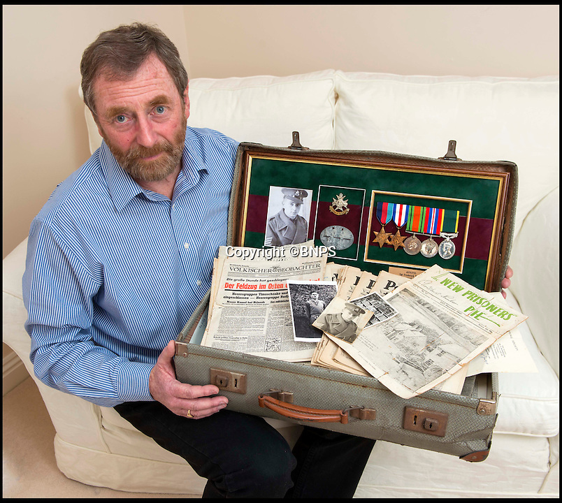 BNPS.co.uk (01202 558833)<br /> Pic: TomWren/BNPS<br /> <br /> Steve Foster with his father's suitcase that contained the incredible documents.<br /> <br /> The poignant story of how a British Prisoner of War paid with his life for turning back for a comrade during an audacious escape has been uncovered in an old suitcase.<br /> <br /> Frederick Foster and Antony Coulthard had travelled 1,000 miles across Poland and Germany before one of them was caught by a German guard on the Swiss border.<br /> <br /> Coulthard, who was free, went back for him and was also caught. He went on to die on a 'death march' towards the end of the war. <br /> <br /> Now Sgt Foster's son Steve is turning the epic escape into a book.