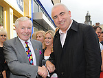 Fergal Quinn meets Padraig Kierans president of Drogheda Chamber of Commerce at the official opening of the Local Heroes office on West street. Photo: Colin Bell/pressphotos.ie
