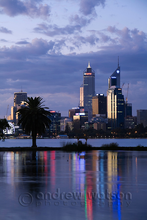 View across James Mitchell Park and the Swan River to the city skyline at dusk.  Perth, Western Australia, AUSTRALIA.