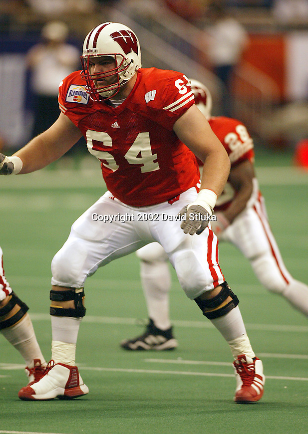 University of Wisconsin offensive lineman Ben Johnson (64) during the Alamo Bowl in San Antonio, Texas. The Badgers beat the University of Colorado in overtime 31-28 on 12/28/02. (Photo by David Stluka)