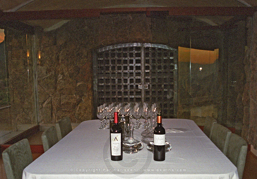 In the tasting room in the winery: a bottle of Altair and a bottle of Sideral on a table with a white table cloth, Bodega Altair in Region del Maule, Chile