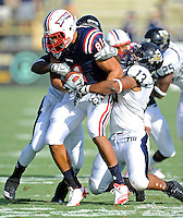 30 October 2010:  FIU linebacker Toronto Smith (13) combines to tackle Florida Atlantic tight end Rob Housler (81) in the first quarter as the Florida Atlantic University Owls defeated the FIU Golden Panthers, 21-9, at Lockhart Stadium in Fort Lauderdale, Florida.