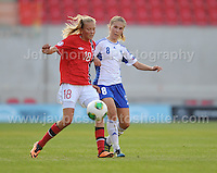 Synne Jensen of Norway battles with Erika Winter of Finland during the UEFA Womens U19 Championships at Parc y Scarlets, Monday 19th August 2013. All images are the copyright of Jeff Thomas Photography-www.jaypics.photoshelter.com-07837 386244-Any use of images must be authorised by the copyright owner.