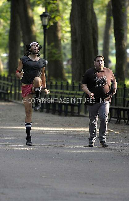 WWW.ACEPIXS.COM . . . . .  ....July 30 2009, New York City....Actors Russell Brand (L) and Jonah Hill on the Central Park set of the new movie 'Get him to the Greek' on July 30 2009 in New York City....Please byline: AJ Sokalner - ACEPIXS.COM..... *** ***..Ace Pictures, Inc:  ..tel: (212) 243 8787..e-mail: info@acepixs.com..web: http://www.acepixs.com