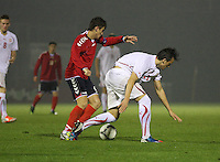 Gor Malakyan (left) and Albion Avdijaj challenge in the Armenia v Switzerland UEFA European Under-19 Championship Qualifying Round match at New Douglas Park, Hamilton on 11.10.12..