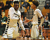 Jalen Burgess #5, left, and Yasir Lawrence #1 of Elmont react as their team closes in on a 41-32 win over Harborfields in the Class A varsity boys basketball Long Island Championship at LIU Post on Sunday, Mar. 6, 2016. Burgess scored 16 points to lead the Spartans to victory.