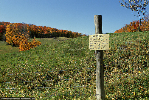 Funny warning sign on edge of  New England Field, Vermont, USA