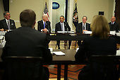 United States President Barack Obama (C) speaks as Vice President Joseph Biden (2nd L) listens during a Democratic Governors Association Meeting in the Eisenhower Executive Office Building February 20, 2015 in Washington, DC. The nation's governors are in Washington, DC, to attend the National Governors Association's Winter Meeting. <br /> Credit: Alex Wong / Pool via CNP