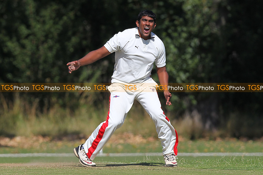 P Jayaprakash in bowling action for Gidea Park - Gidea Park & Romford CC vs Hornchurch CC - Essex Cricket League at Gallow Corner - 31/08/13 - MANDATORY CREDIT: Gavin Ellis/TGSPHOTO - Self billing applies where appropriate - 0845 094 6026 - contact@tgsphoto.co.uk - NO UNPAID USE