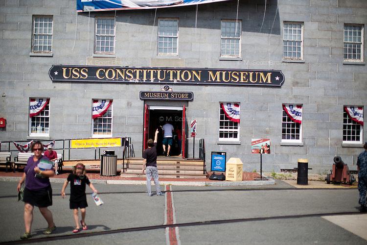 Visitors walk near the USS Constitution Museum in Charlestown Navy Yard in Charlestown, Boston, Massachusetts, USA.