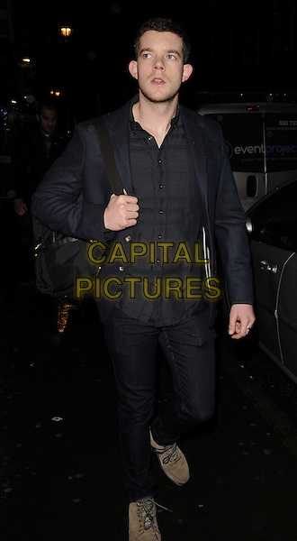 "Russell Tovey.The launch of ""The Bag Issue"" collectible bags made from banana skin fibres & elephant dung (!), The House of St. Barnabas, London, England..December 19th, 2011.full length jeans denim black shirt blue jacket rucksack backpack bag.CAP/CAN.©Can Nguyen/Capital Pictures."