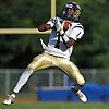 T'Khi Wood-Smith #1 of Baldwin makes an interception during the fourth quarter of a Nassau County Conference I varsity football game against host Hempstead High School on Saturday, Sept. 17, 2016. Baldwin won by a score of 36-28.