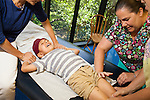 Genevieve Perez, left, and Beth Barnhart administer vaccines shots to Jayden Garay, 15-months-old, as his mother Jessica Garay helps hold him in at Dr. Lindsay Irvin's pediatric office San Antonio, Texas on Wednesday, June 18, 2014.<br /> <br /> Ben Sklar