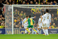 Jonny Howson of Norwich City scores the opening goal, 1-0, during the Barclays Premier League match between Norwich City and Swansea City played at Carrow Road, Norwich on November 7th 2015