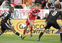 Rodney Wallace #22 and Carey Talley #8 of D.C. United can't stop a pass from Brian McBride #20 of the Chicago Fire during an MLS match on April 17 2010, at RFK Stadium in Washington D.C. Fire won the match 2-0.