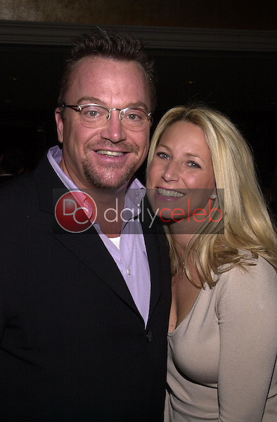 Tom Arnold and wife Julie Champnella