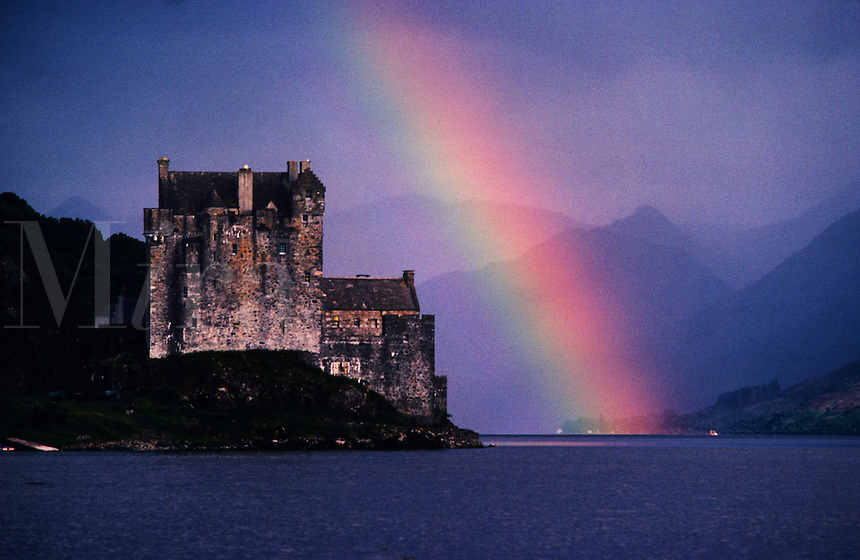 Scotland. Eilean Donan Castle. Western Highlands.  Dramatically and strategically placed on a small island in a sea loch.  This is one of Scotland's most famous and attractive castles seen on a stormy day with a rainbow.