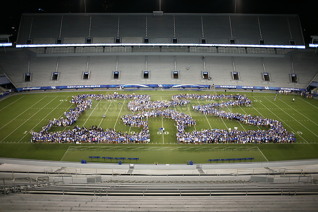 The freshman class of 2016 poses for a picture at Big Blue U at Commonwealth Stadium on Saturday, August 18, 2012. Students were invited to come learn the cheers and fight song and then pose for a picture on the field. Photo by Tessa Lighty | Staff