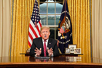 WASHINGTON, DC - JANUARY 08: U.S. President Donald Trump speaks to the nation in his first-prime address from the Oval Office of the White House on January 8, 2019 in Washington, DC. A partial shutdown of the federal government has gone on for 17 days following the president's demand for $5.7 billion for a border wall while Democrats have refused.  (Photo by Carlos Barria-Pool/Getty Images)<br /> CAP/MPI/RS<br /> &copy;RS/MPI/Capital Pictures