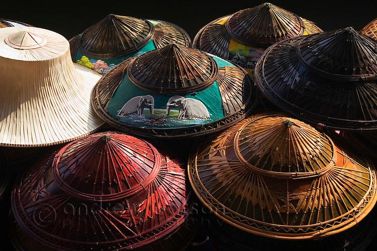 Colourful conical hats for sale at Damnoen Saduak floating market.  Damnoen Saduak, Samut Songkhram, THAILAND.