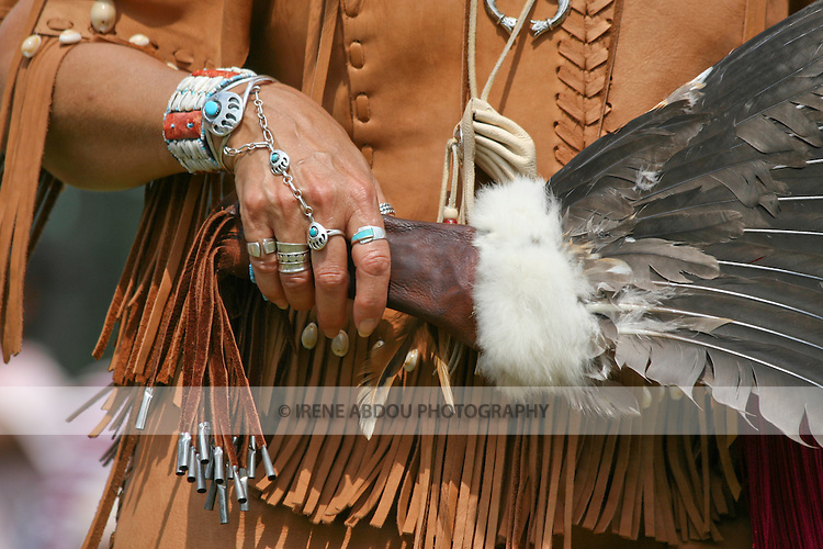 Native American jewelry and fan worn/carried by a dancer at the 8th Annual Red Wing Native American PowWow