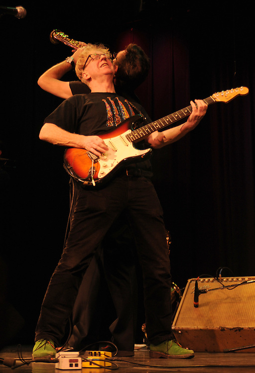 Geoff Blythe (Saxophone), and Larry Kirwan (Stratocaster)-in front- jamming during a performance at the Boulton Center in Bay Shore, Long Island, on Friday, March 4, 2011. Photograph by Jim Peppler. Copyright Jim Peppler/2011.