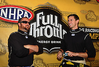 Nov 14, 2010; Pomona, CA, USA; NHRA top fuel dragster drivers Shawn Langdon (left) and teammate Morgan Lucas during the Auto Club Finals at Auto Club Raceway at Pomona. Mandatory Credit: Mark J. Rebilas-