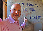 "9 June 2012: Washington Nationals General Manager Mike Rizzo signs the wall inside the famed ""Green Monster"" scoreboard wall with the message: ""See You Guys in the World Series"" prior to a game against the Boston Red Sox at Fenway Park in Boston, MA. The Nationals defeated the Red Sox 4-2 in the second game of their 3-game series. Mandatory Credit: Ed Wolfstein Photo"