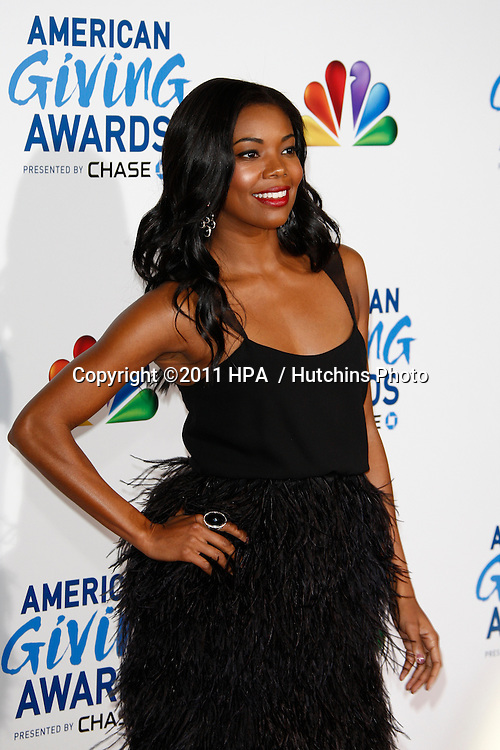 LOS ANGELES - DEC 9:  Gabrielle Union arrives at the 2011 American Giving Awards at Dorothy Chandler Pavilion on December 9, 2011 in Los Angeles, CA
