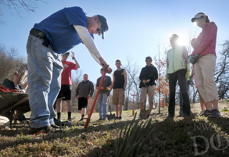 NWA Democrat-Gazette/BEN GOFF @NWABENGOFF<br /> Ralph Weber, board member of the Illinois River Watershed Partnership, demonstrates how to use a dibble bar to plant trees on Saturday March 5, 2016 as volunteers help plant native trees and shrubs next to the North Bentonville Trail as part of the partnership's 9th annual spring Riparian Project. The group planted roughly 150 trees and shrubs at the location, with other groups planting at eight other locations in Northwest Arkansas and Eastern Oklahoma.