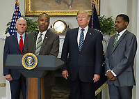 United States Secretary of Housing and Urban Development Ben Carson makes remarks prior to US President Donald J. Trump signing a proclamation to honor Dr. Martin Luther King, Jr. Day in the Roosevelt Room of the White House in Washington, DC on Friday, January 12, 2018.  From left to right: US Vice President Mike Pence, Secretary Carson, President Trump and Isaac Newton Farris, Jr., Nephew of Martin Luther King Jr.<br /> CAP/MPI/RS<br /> &copy;RS/MPI/Capital Pictures