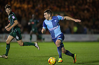 Matthew Bloomfield of Wycombe Wanderers looks to get past Connor Smith of Plymouth Argyle during the Sky Bet League 2 match between Plymouth Argyle and Wycombe Wanderers at Home Park, Plymouth, England on 26 December 2016. Photo by Mark  Hawkins / PRiME Media Images.