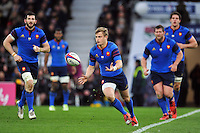 Jules Plisson of France passes the ball. RBS Six Nations match between England and France on March 21, 2015 at Twickenham Stadium in London, England. Photo by: Patrick Khachfe / Onside Images