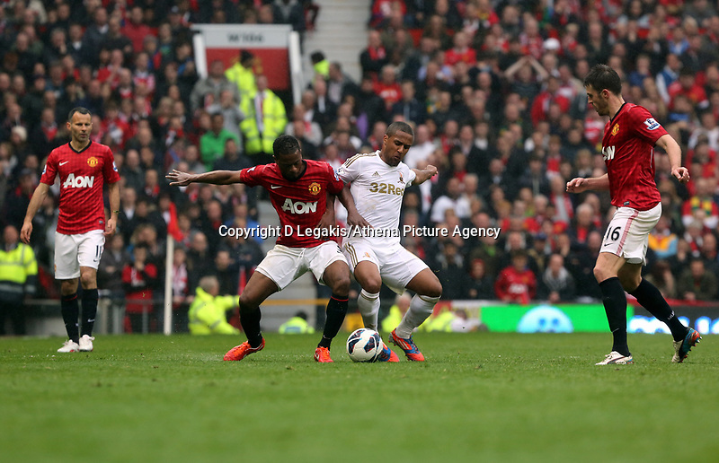 Pictured: (L-R) Patrice Evra, Wayne Routledge.<br /> Sunday 12 May 2013<br /> Re: Barclay's Premier League, Manchester City FC v Swansea City FC at the Old Trafford Stadium, Manchester.