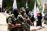 Members of al-Ansar brigades, the armed wing of al-Ahrar movement stand guard during a rally to mark the 8th anniversary of the movement's foundation in Gaza city on July 7, 2015. Photo by Ashraf Amra