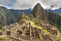 "Huayanapichu (young mountain) in the distance at Machu Picchu, the ancient ""lost city of the Incas"", 1400 CA, 2400 meters. Discovered by Hiram Bingham in 1911. One of Peru's top tourist destinations."