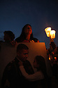 A mother grieves for her son during a candlelight vigil during anti-war protests in Washington, DC in September of 2005