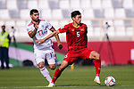 Doan Van Hau of Vietnam (R) fights for the ball with Mehdi Taremi of Iran (L) during the AFC Asian Cup UAE 2019 Group D match between Vietnam (VIE) and I.R. Iran (IRN) at Al Nahyan Stadium on 12 January 2019 in Abu Dhabi, United Arab Emirates. Photo by Marcio Rodrigo Machado / Power Sport Images